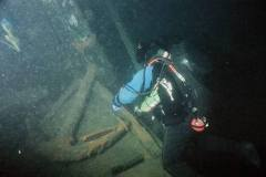 Diver-examines-wood-stock-anchor-in-bow-area