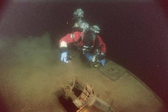 Diver-examines-telegraph-base-on-top-of-pilothouse