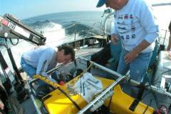 Executive-Director-Tom-Farnquist-and-Engineer-Bob-Smith-prepare-the-ROV-for-its-dive