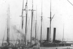 Twin stacked Samuel Mather (right) with her two tows, H.R. Newcombe (left) and Red Wing.