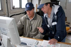 John-DeMille-of-Marine-Sonics-and-Executive-Director-Tom-Farnquist-examine-sonar-data