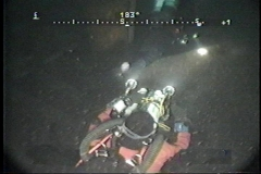 Diver-with-video-camera-at-145-Feet