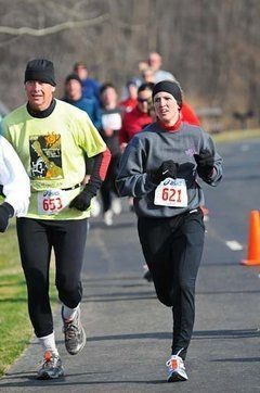 Rob Koleski (left) running for the Ronald McDonald House in Lansing